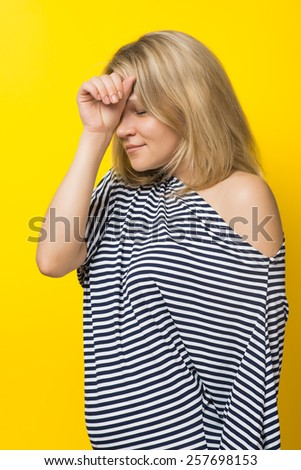 distraught woman put her hand to her forehead - stock photo