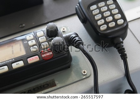 Distress call button on two way radio - stock photo