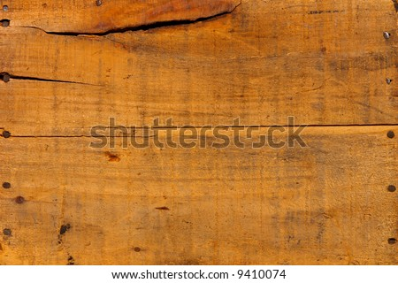 Distressed antique wood plank barn wood boards with old nails background - stock photo