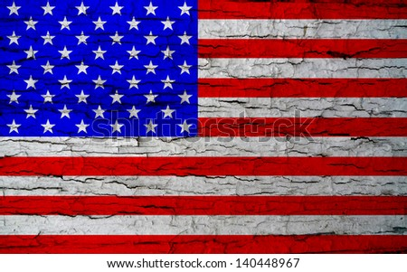 Distressed US flag; American stars and stripes flag, sprayed or graffitied onto urban wall  - stock photo