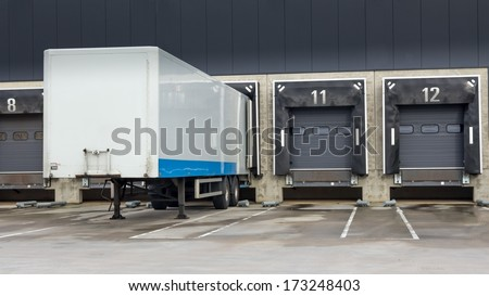 Distribution center with docking station for trucks - stock photo