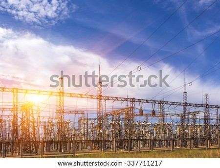 distribution electric substation with power lines, at sunset - stock photo