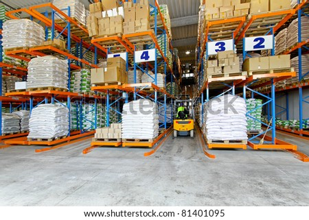 Distribution warehouse interior with racks and shelves - stock photo