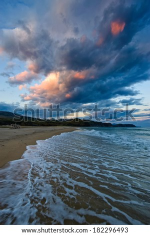 Disturbing evening on the shore of the East Sea. - stock photo