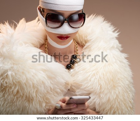 Diva text messaging after having rhinoplasty - stock photo