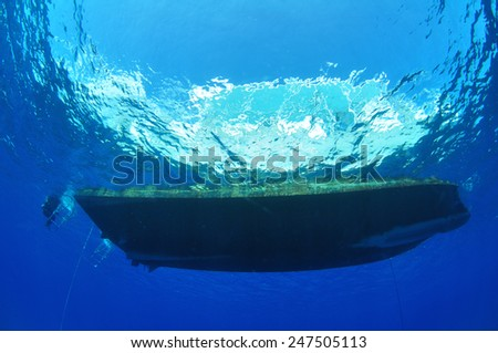 Dive Boat on the Surface on a calm day, Grand Cayman - stock photo
