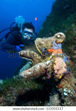 Diver and underwater bear, mediterranean sea, island Elba, Italy - stock photo