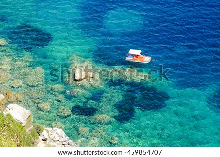 Diver doing snorkeling in the blue waters in Greece. Corfu island Kerkyra. Solo divers in the water. - stock photo