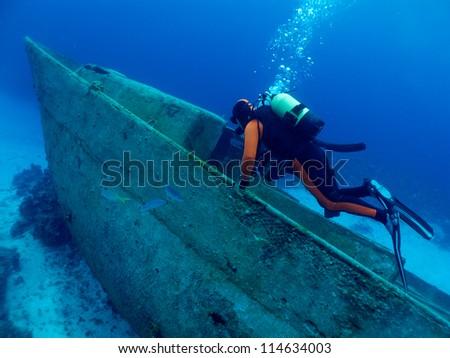 diver explore a wrack - stock photo