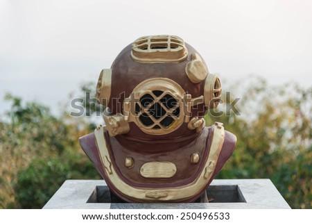 diver's helmet statue - stock photo