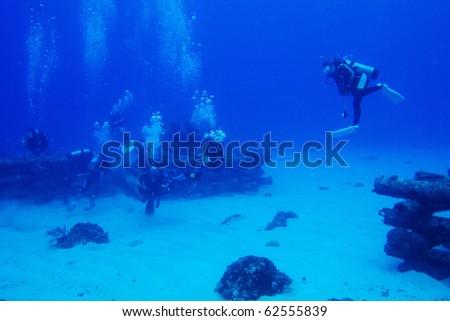 diver swimming underwater - stock photo