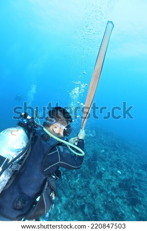 Diver using survival float before getting up to water. - stock photo