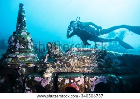 diver visit buddha underwater - stock photo