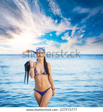 diver woman wearing goggles, tube and flippers - stock photo