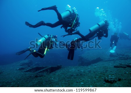 Divers and Marine shipwreck (Fort Marion) - stock photo