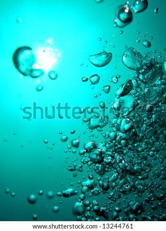 Divers bubbles ascend - stock photo