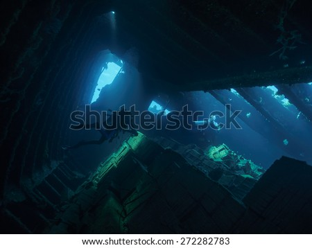 Divers inside shipwreck Markus - stock photo