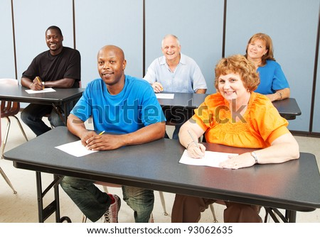 Diverse adult education class, various ages and ethnicities, smiling and happy. - stock photo