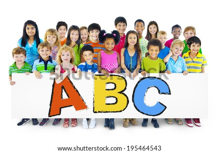 Diverse Cheerful Children Holding Letters - stock photo