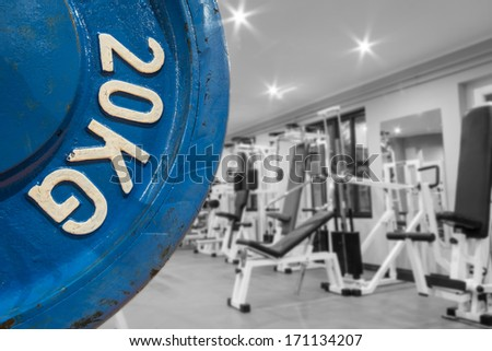 Diverse equipment and machines at the gym room - stock photo