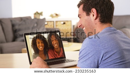 Diverse friends videochatting on laptop - stock photo
