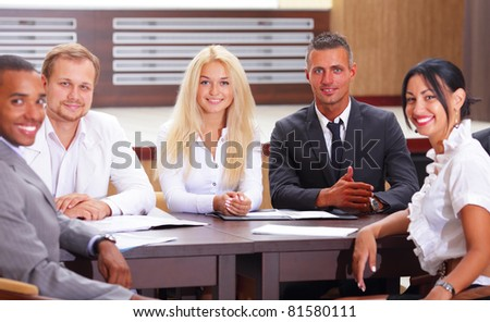 Diverse group of business people having a meeting - stock photo