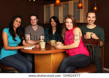 Diverse Group of Friends Bible Study in Cafe - stock photo