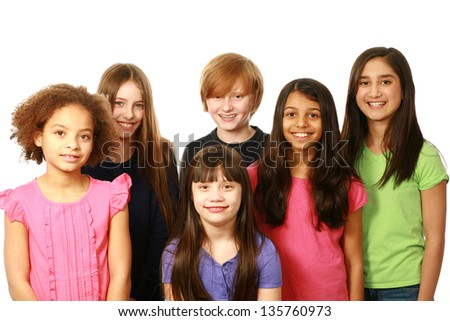 diverse group of kids smiling on white background - stock photo