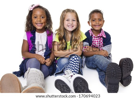 Diverse group of school kids isolated on white background. Smiling and happy children. - stock photo