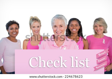 Diverse group of women wearing pink tops and breast cancer ribbons against pink card - stock photo