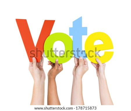 Diverse Hands Holding Colorful Vote - stock photo