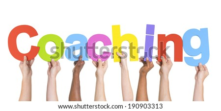 Diverse Hands Holding The Word Coaching - stock photo