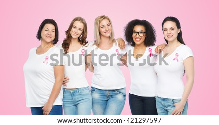 diverse, healthcare and people concept - group of happy different size women in white t-shirts with pink breast cancer awareness ribbon over pink background - stock photo