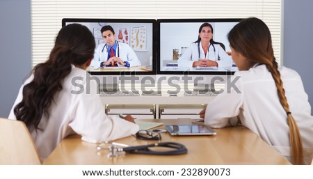 Diverse team of medical doctors having a meeting - stock photo
