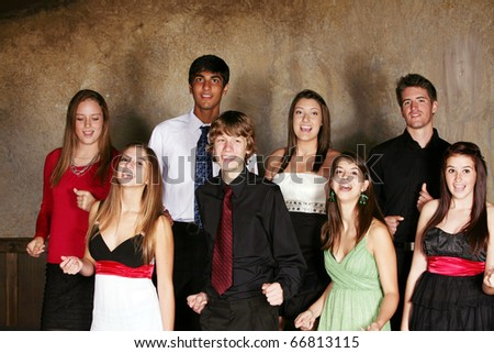 diverse teens singing and performing in choir in formal dress - stock photo