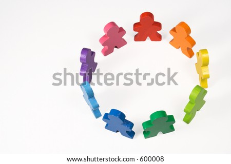 Diversity and Teamwork - Colorful toy people standing in a circle. - stock photo