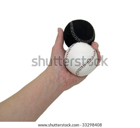 Diversity as shown by holding out two different but equal baseballs - path included - stock photo