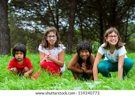 Diversity Portrait of latin and handicapped girlfriends together outdoors. - stock photo