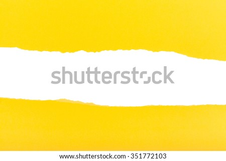 divided halves of the sheet of yellow ripped paper on white background - stock photo