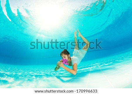 diving girl with flowers - stock photo