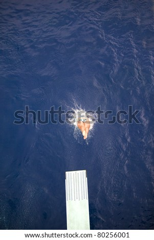 Diving into the water - stock photo
