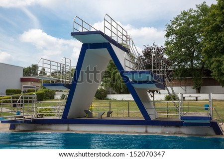 Diving platform at public swimming pool - stock photo
