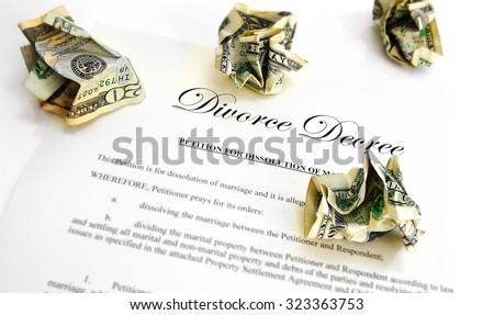 Divorce decree and crumpled up money - stock photo