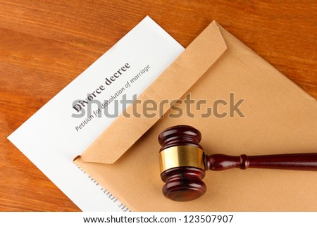 Divorce decree and envelope on wooden background - stock photo