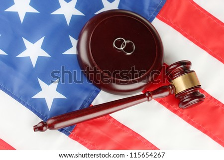 Divorce decree and wooden gavel on american flag background - stock photo
