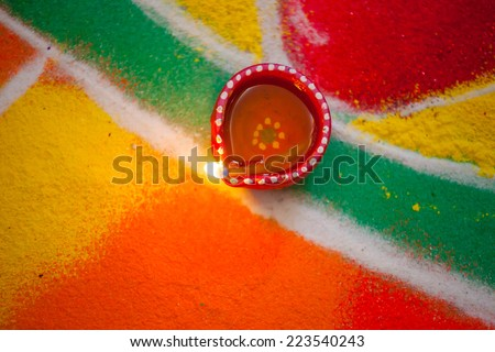 Diya with Colours during diwali - stock photo