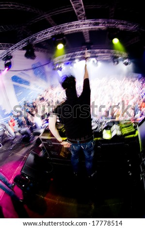 Dj at the concert, laser show and music - stock photo