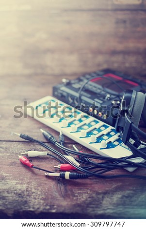 DJ equipment on rustic wooden background - stock photo