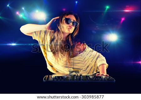 Dj girl dancing with light on background - stock photo