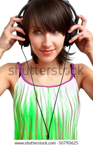 DJ girl putting her headphones on and smiling - stock photo